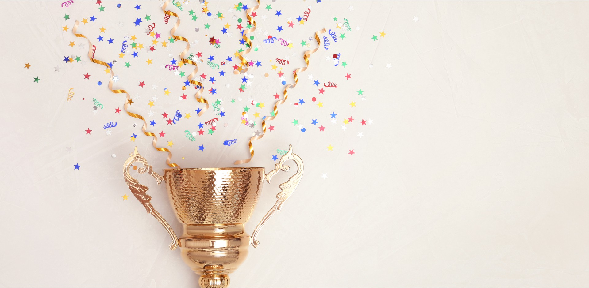 Trophy on white background with confetti coming out